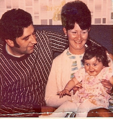 Julie with her parents in 1971