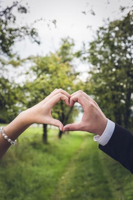 couple making heart shape with hands, unsplash.com