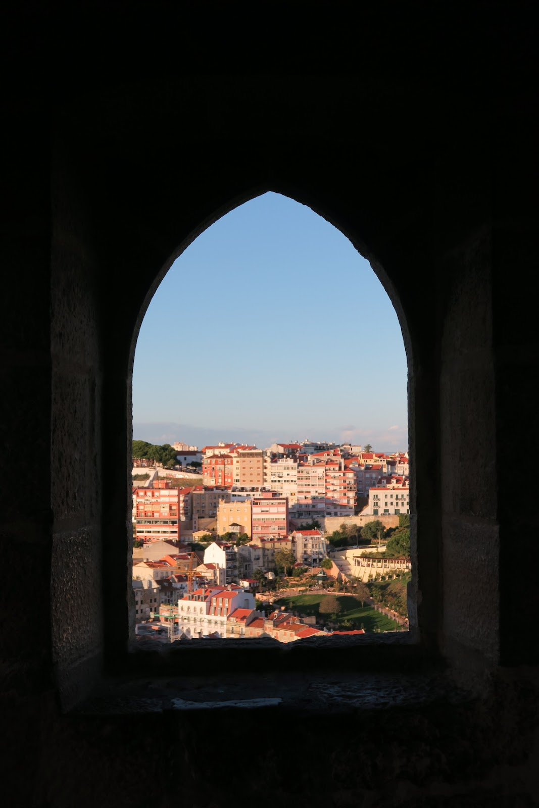 This is a shot from the inside of theSão Jorge Castle and shows the incredible views outside the open window.