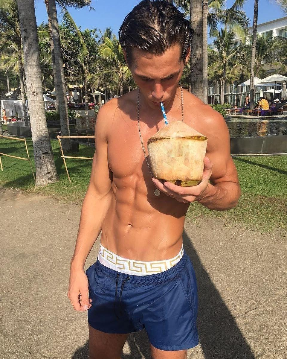 cute-fit-hair-gel-college-sixpack-abs-boy-drinking-coconut