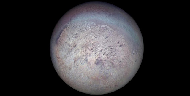Voyager 2 image of Triton showing the south polar region with dark streaks produced by geysers visible on the icy surface. Credit: NASA/JPL.