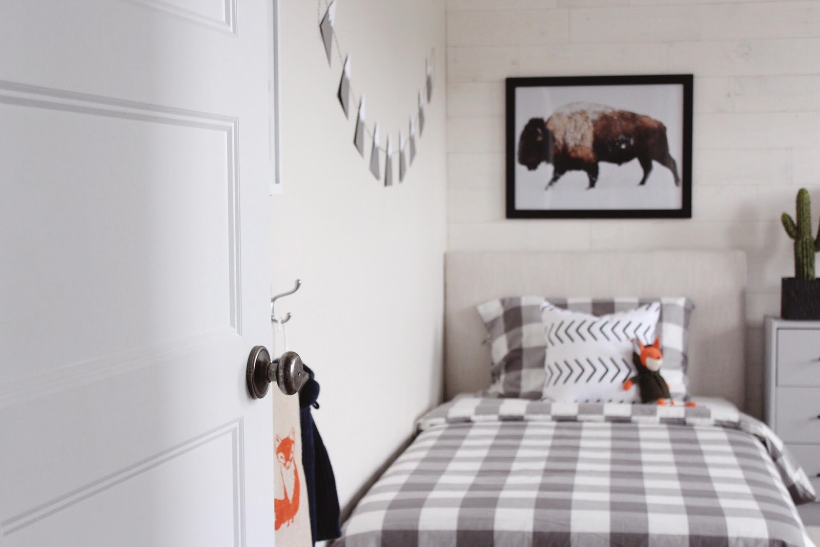 Modern rustic kids bedroom - There Are A Couple Of Key Elements That I Feel Really Make This Space First Being The Stikwood Rustic Shiplapped Accent Wall This Wall Is In The Hamptons