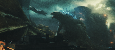 Godzilla: King of the Monsters 2019 movie still of Godzilla fighting Ghidorah