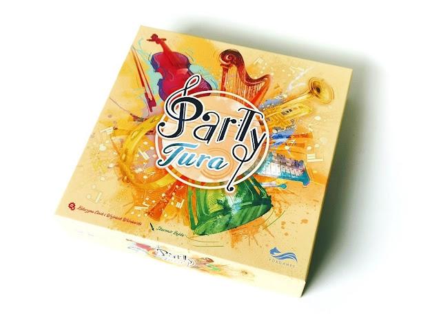 na zdjęciu pudełko gry partytura z rysunkami instrumentów na żółtym tle