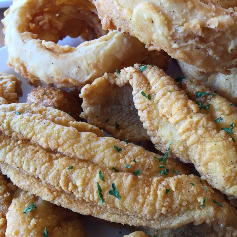 Fried catfish, hushpuppies and onion rings at Buff's Cafe in New Roads, Louisiana