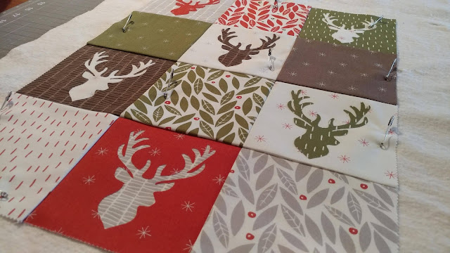 Christmas deer quilt using Merrily by Moda and Aurifil thread