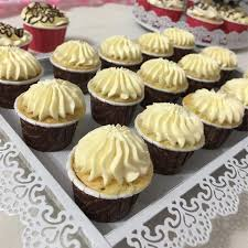 Beatifully designed white and brown cupcakes