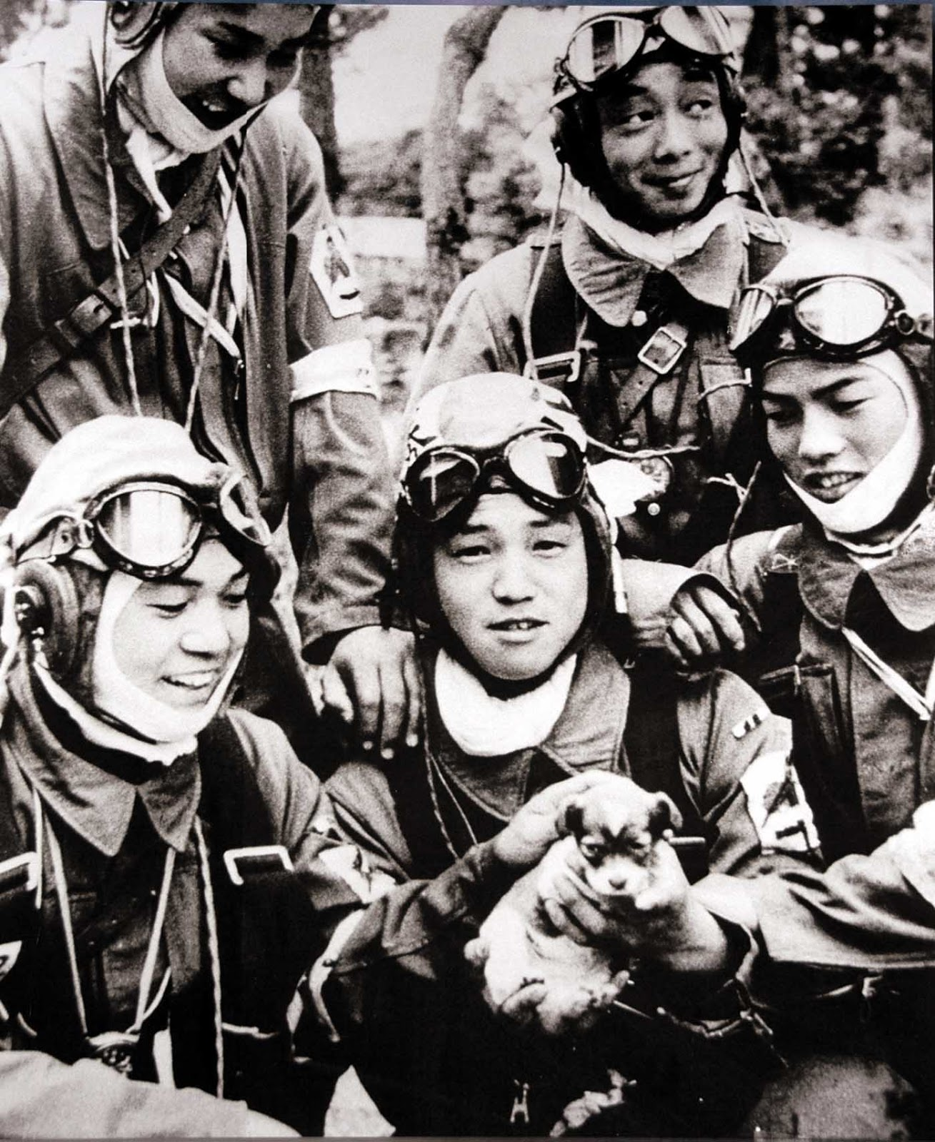 Corporal Yukio Araki (center) holds a puppy in a group photo taken one day before his death, 1945