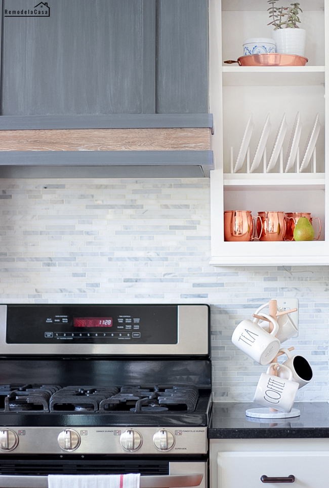 grey range hood with a lower wooden band