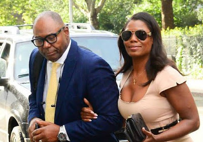 John Allen Newman coming out from the car with his wife Omarosa