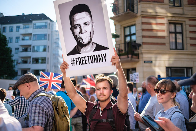 """Tommy Robinson was Given to nine months in prison for contempt of court Tommy Robinson has been given to nine months in prison - of which he will serve about 10 weeks - when he was found guilty of contempt of the court in the earlier hearing. Robinson, whose real name is Stefan Yakle-Lennon, has circulated the reports, which encouraged """"vigilance action"""" and """"illegal physical"""" aggression against the defendants in the sexual abuse lawsuit, according to the judges who were convicted last week. Was found. Guardian Today: In the headlines, analysis, debate - Directly sent to you, supporters of a former South-East English Defense League supporter have reacted angrily on Thursday after the news of the conviction filmed through the crowd outside Old Bailey. Expressed where the police donated to the rioters and riot helmets after throwing bottles attracted.  After this the crowd marched on the crossroads of Parliament, where police threatened journalists and intervened after verbally abusing the police, before some attorneys gathered at the General's offices, who applied for keeping Robinson in jail Was there.  After being convicted of Robinson last Friday, a 50-year-old man was arrested outside Westminster Abbey on charges of alleged rape outside the Old Bailey. Two other men and two women were also arrested on Thursday in connection with alleged crimes. Robinson supporters outside Parliament's Houses Photo: Peter Nicholls / Reuters  While delivering the conviction on Thursday, Dame Victoria Sharpe said about Robinson: """"He lied in many cases and called himself a victim of unfair and oppression.  """"It does not extend its punishment, but it means that there can be no shortfall for admission of crime, or for contradiction or repentance.""""  Robinson, 36, of Luton in Badfordshire, refused to break the reporting ban by livestreaming footage of the defendants who arrived in court. He stressed that he only mentioned information in public domain already.  After deduction for serving """