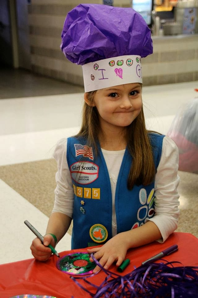 An official Girl Scout photographer snapped this pic of Tessa finishing up her cookie goal door hanger at Cookie Rally 2014. It was later posted on the Girl Scouts of Eastern Missouri Facebook page.
