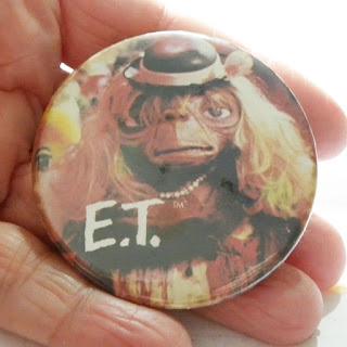 Original ET badge hiding in cupboard wearing wig