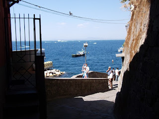 The passage through the walls at the Greek Gate opens on to a view of fishing boats bobbing on the sea