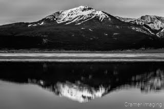 Cramer Imaging's black and white or monochrome fine art landscape photograph of a mountain reflecting in a calm lake