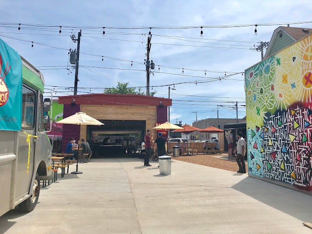 Murals and seating, along with a bar at the Zocalo Food Park