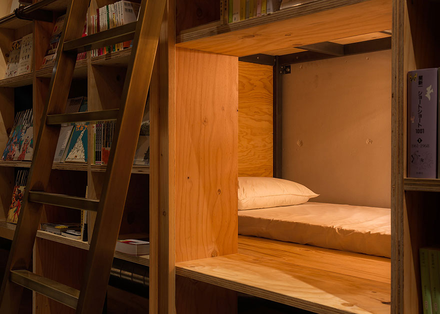 Bookshelf-beds provide an interesting place to sleep - Bookstore-Themed Tokyo Hotel Has 1,700 Books And Sleeping Shelves Next To Them