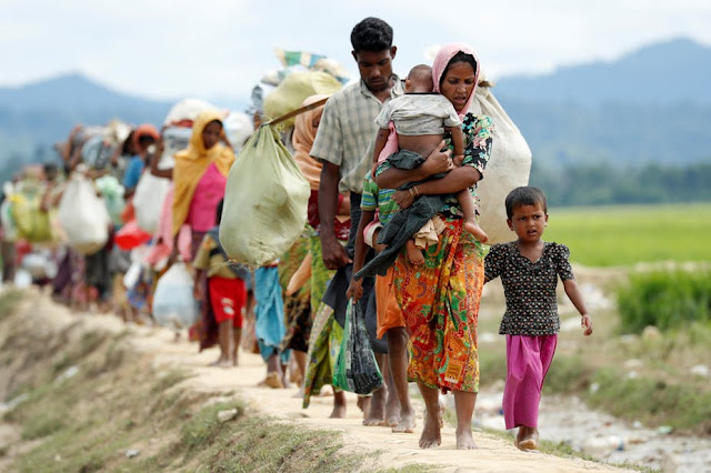 Image Attribute: A file photo of Rohingya refugees walking from Myanmar to refugee camps in Bangladesh. / Dated: September 24, 2017,/ Source: REUTERS/Jorge Silva