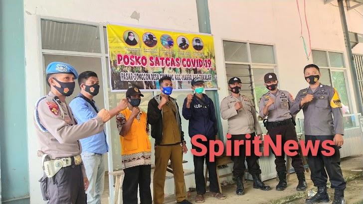 Berdayakan Posko Covid-19, Bhabinkamtibmas Desa Cikoang Himbau Masyarakat Patuhi Protokol Kesehatan