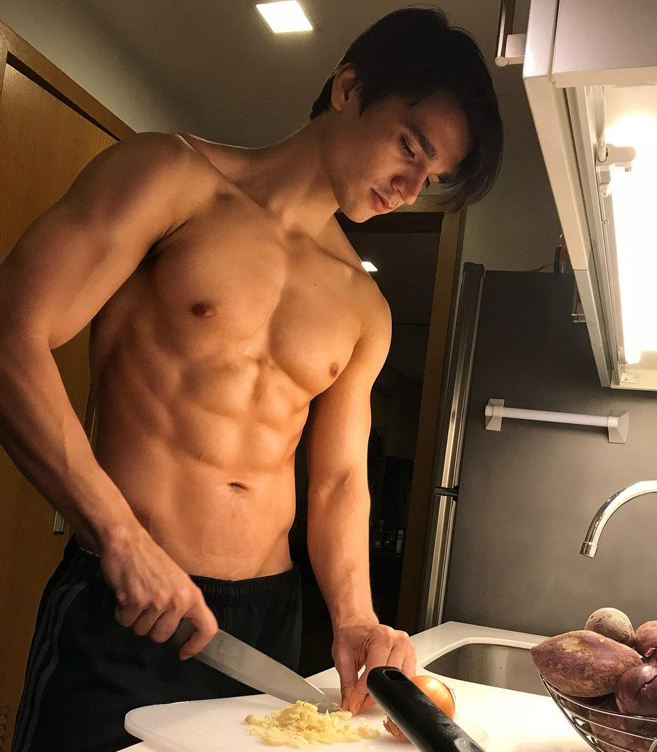cute-young-shirtless-fit-guy-preparing-food-kitchen-sexy-cook