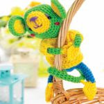 http://www.topcrochetpatterns.com/images/uploads/pattern/Amigurumi-monkey-toy.pdf