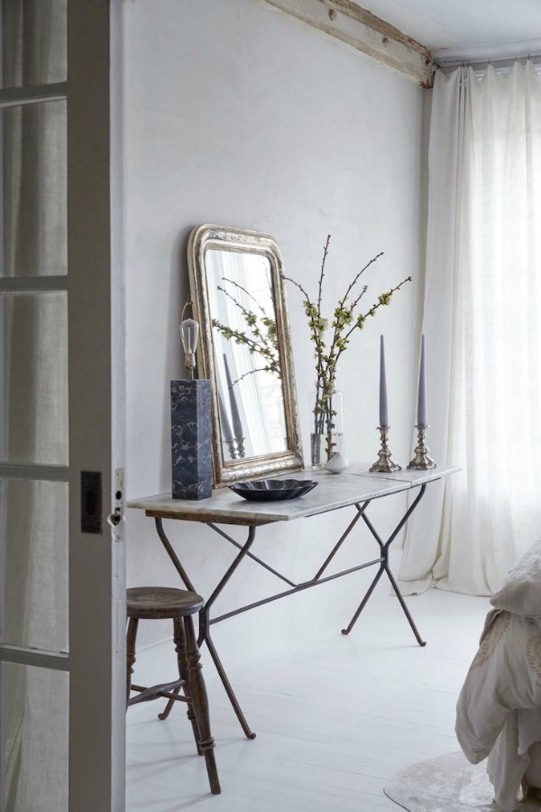 French Farmhouse White Decorating Ideas. A side table in the bedroom serves as a still-life tableau.