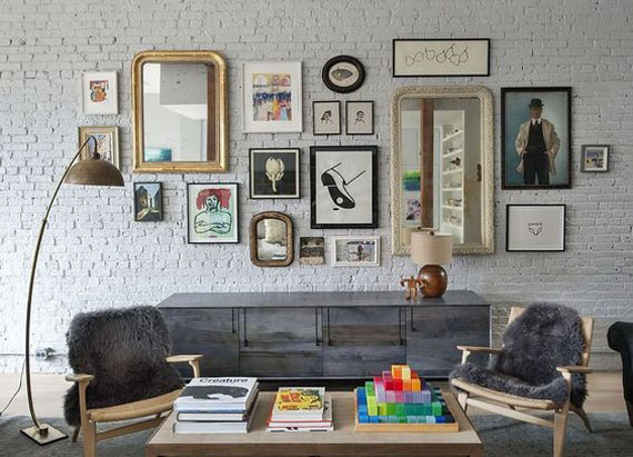 brick wall, framed prints and mirrors art composition,
