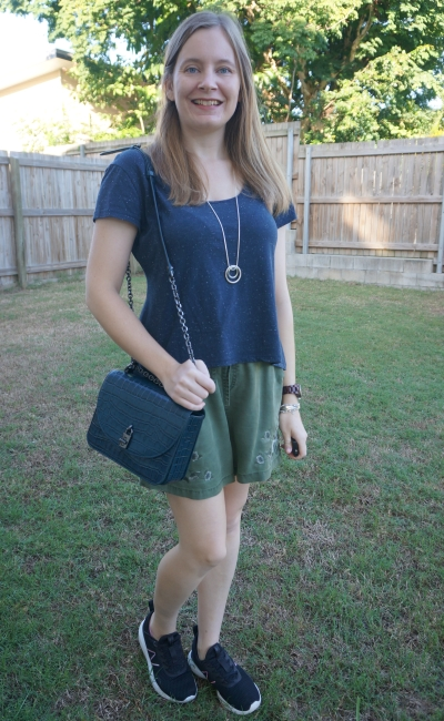 navy scoop neck cropped tee with olive embroidered pull on shorts sneakers rebeca minkoff love too bag