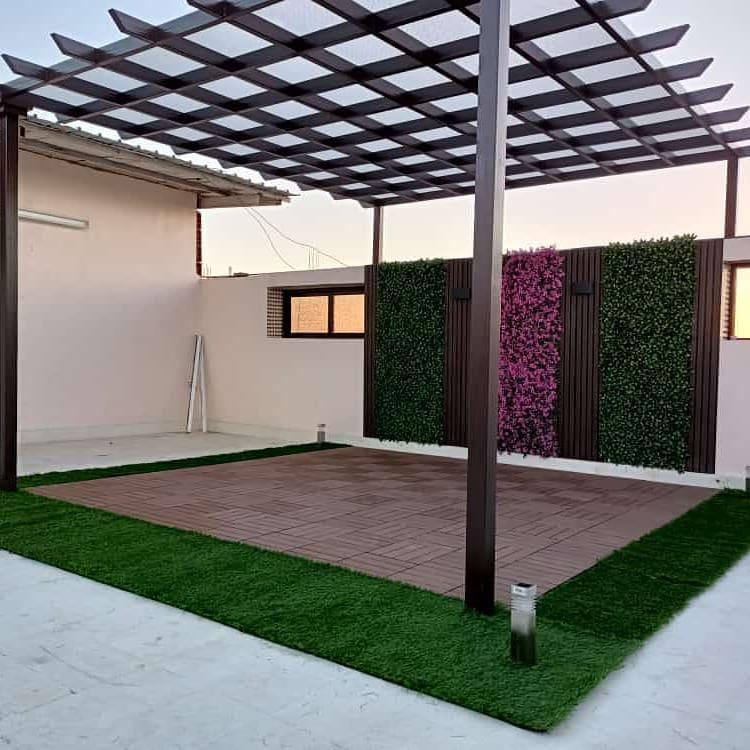 شركة تنسيق حدائق منزليه استراتجية تصاميم حدائق بالعشب الصناعي