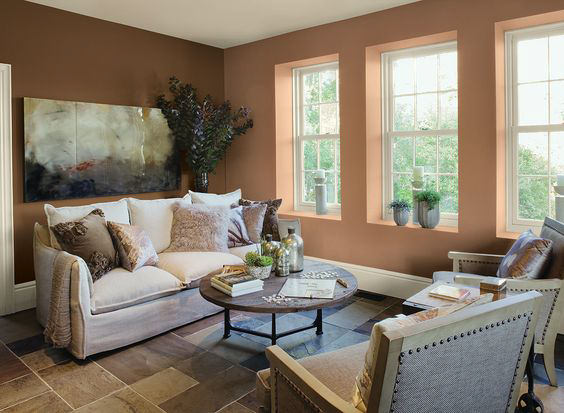 living room with cozy sofa and throw pillows and walls painted with Benjamin Moore Potters Clay