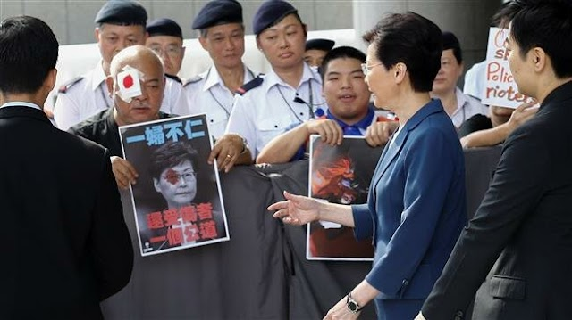 Hong Kong's Chief Executive Carrie Lam asks protesters to 'calm down'