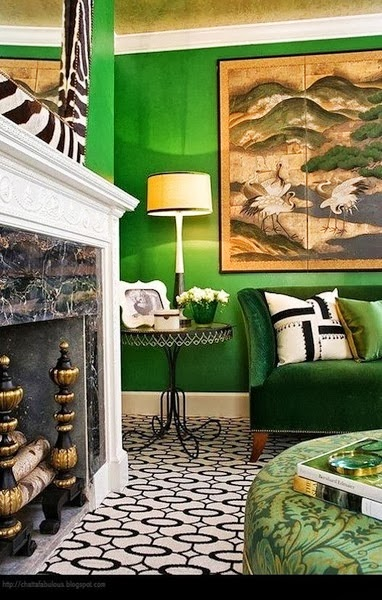 gorgeous emerald green wall and sofa in a living room