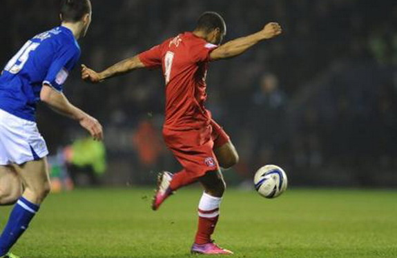 Charlton player Danny Haynes shoots to score against Leicester