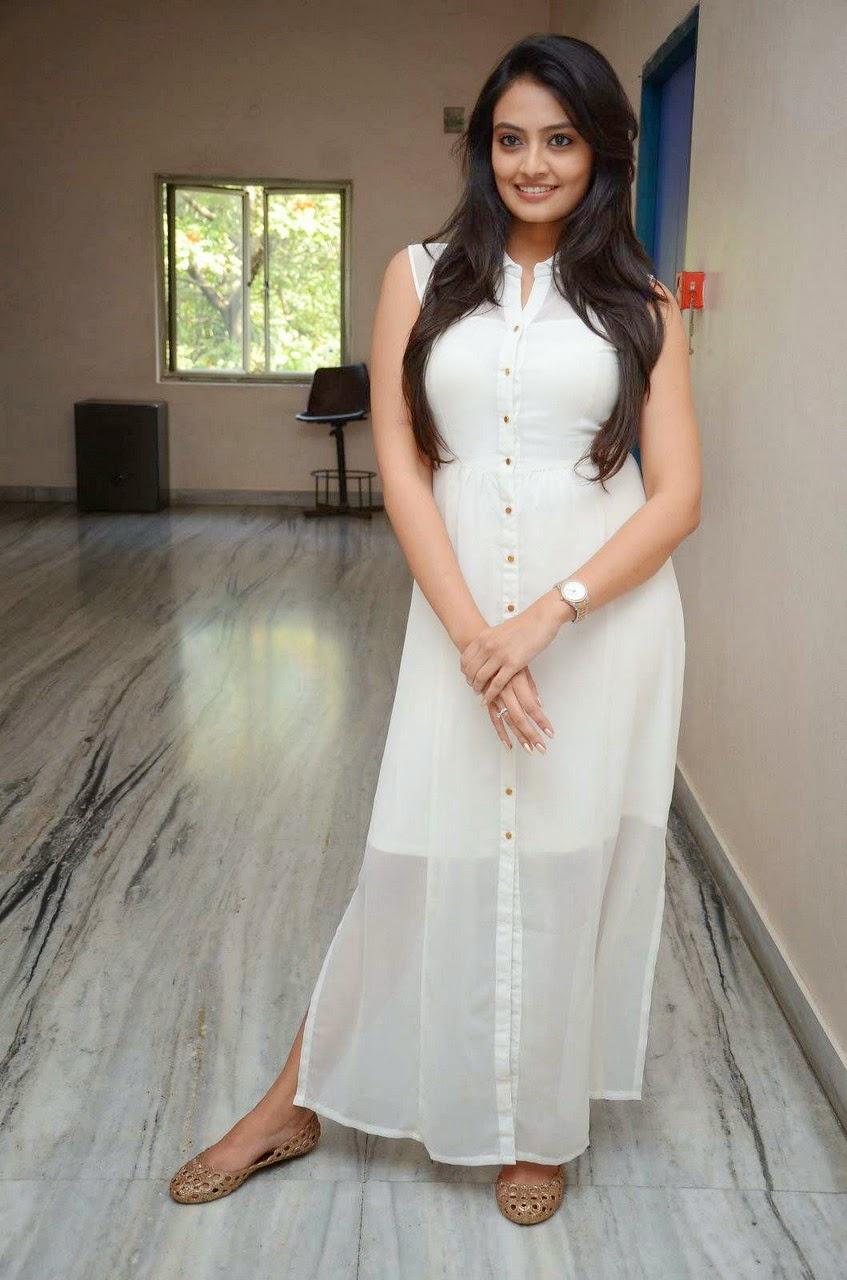 Actress Nikitha Narayana Long Hair Stills in White Dress