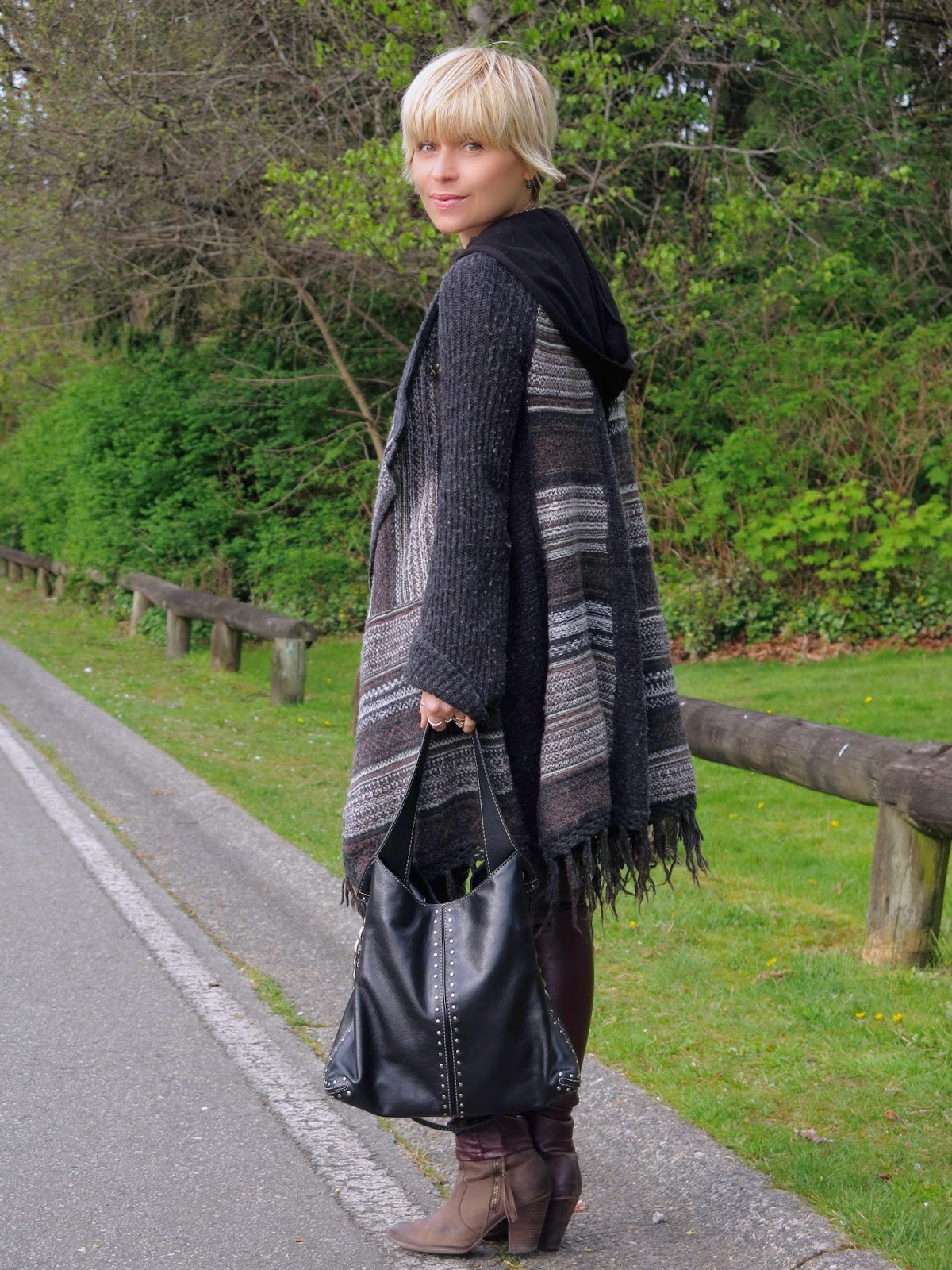 styling a fringy Free People cardigan with burgundy faux-leather leggings