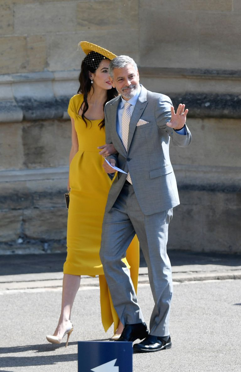 Amal Clooney stuns in yellow at Harry and Meghan's wedding