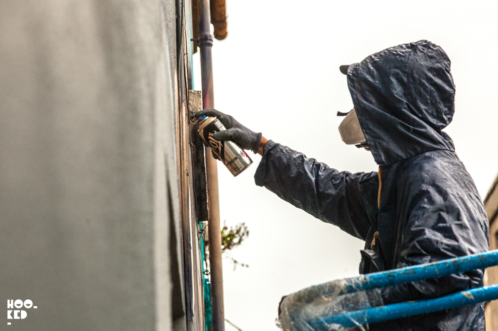 Street Artist Ador at work with spraycan