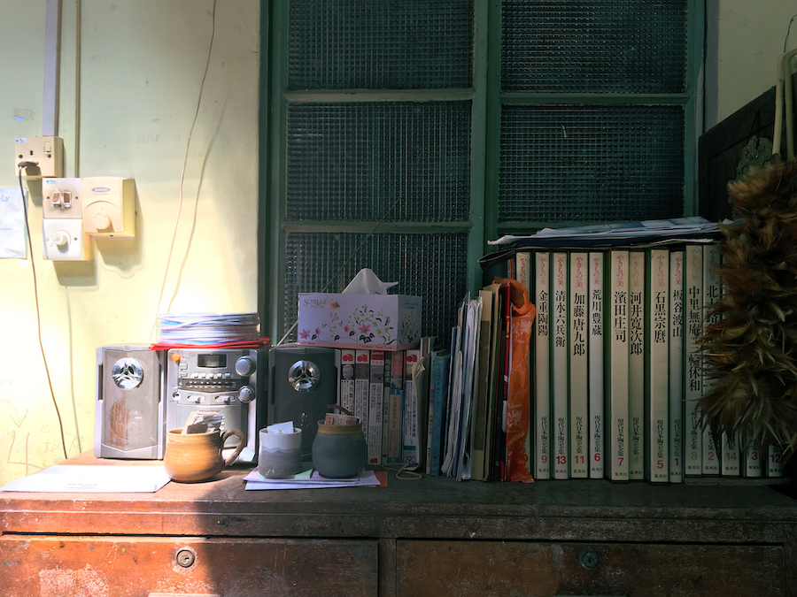 Old dusty books and sunlight in an antique store of Malacca Malaysia