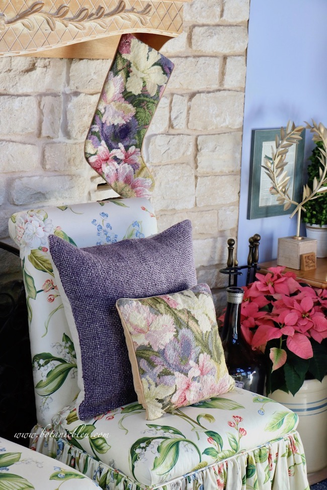 French country Christmas living room tour begins with jewel tone Christmas stockings