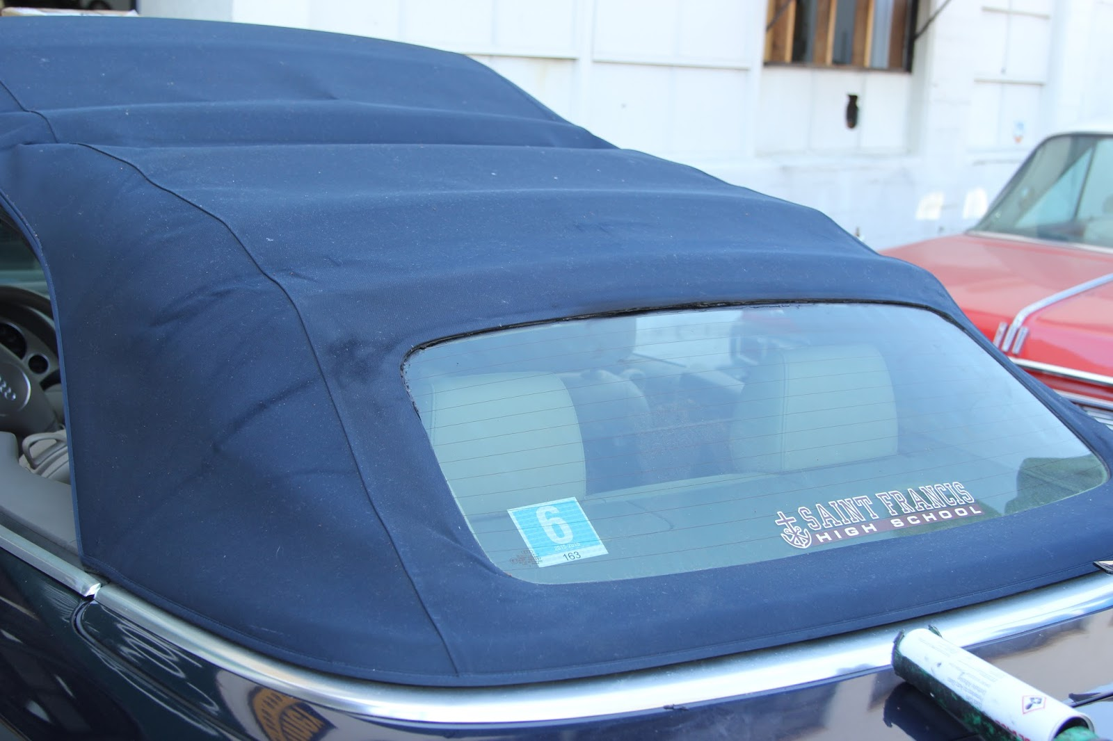 A Customer Had The Convertible Top Pulled Loose From Rear Window We Have Reglued With Urethane Compound