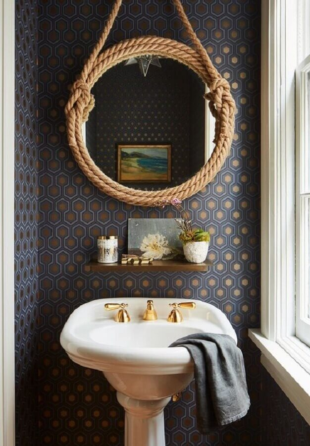The round bathroom mirror with cut handle stands out in the decoration