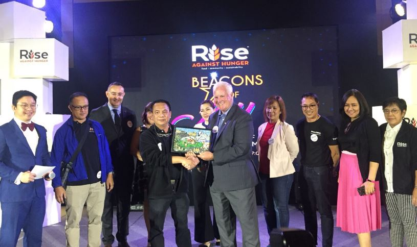 The country's beacons of joy come together to launch Rise Against Hunger's 'This is possible.'