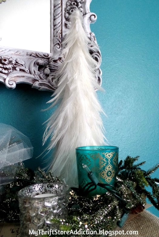 Creating Christmas: A Very Thrifty Christmas mythriftstoreaddiction.blogspot.com Thrift store feather tree nestled among glittery garland and festive candles