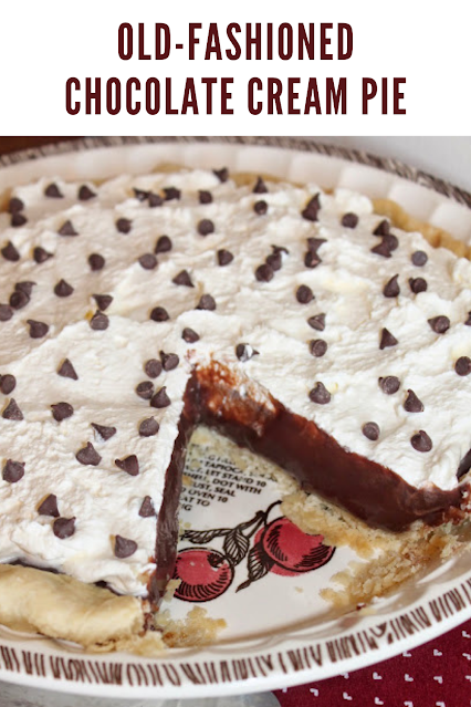 Close-up of the filling of a chocolate cream pie showing the layer of chocolate pudding and whipped cream.