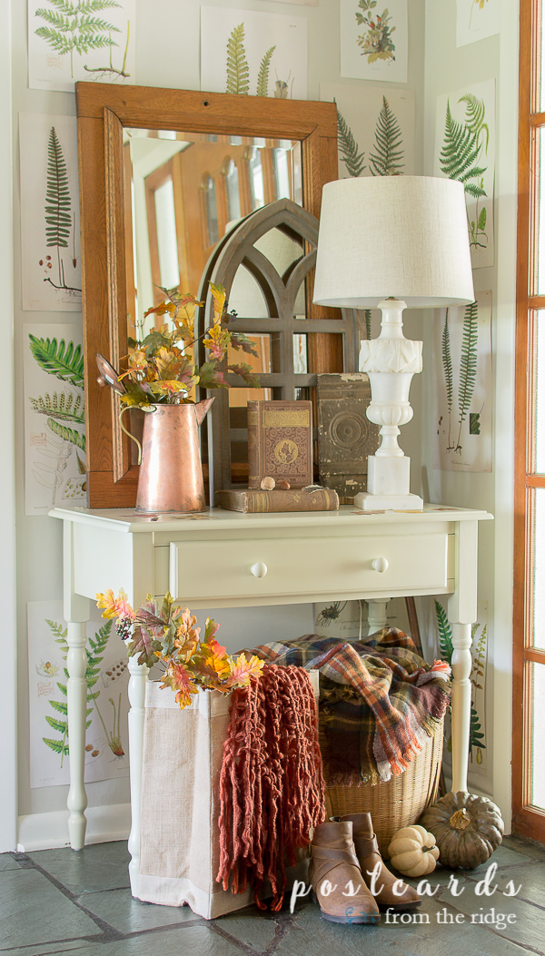 entry with white table and lamp and traditional colored fall decor
