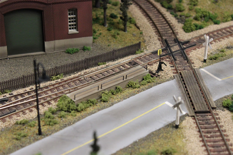 A custom built styrene platform to cover an unsightly Atlas trackside switch machine