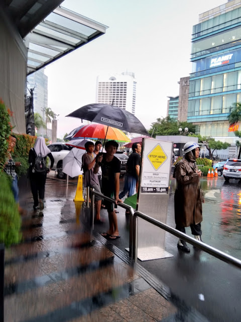 ojek payung jakarta, happyone