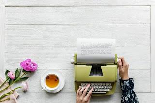 Lady Using A Typewriter