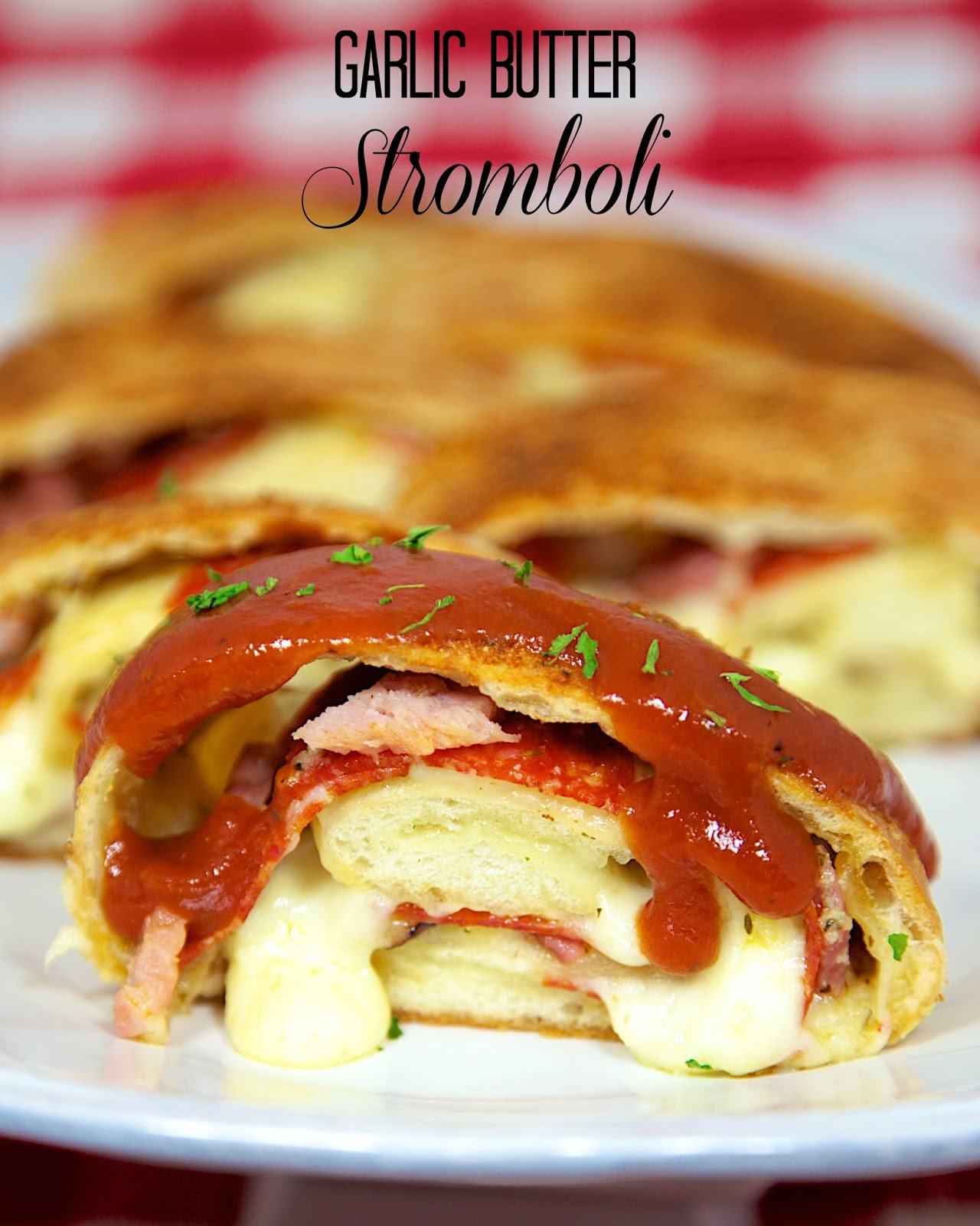 Garlic Butter Stromboli - pizza dough slathered with garlic butter and stuffed with pepperoni, ham and mozzarella. Serve with warm pizza sauce.