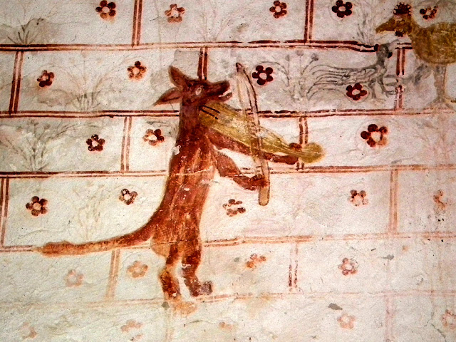 Detail of wall painting depicting the Roman de Renart in the Chapelle de Plaincourault, Indre, France. Photographed by Susan Walter. Tour the Loire Valley with a classic car and a private guide.